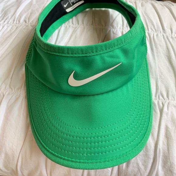 green nike visor. M 5c33bdeafe515137d318ec7f 5a605e13bf7